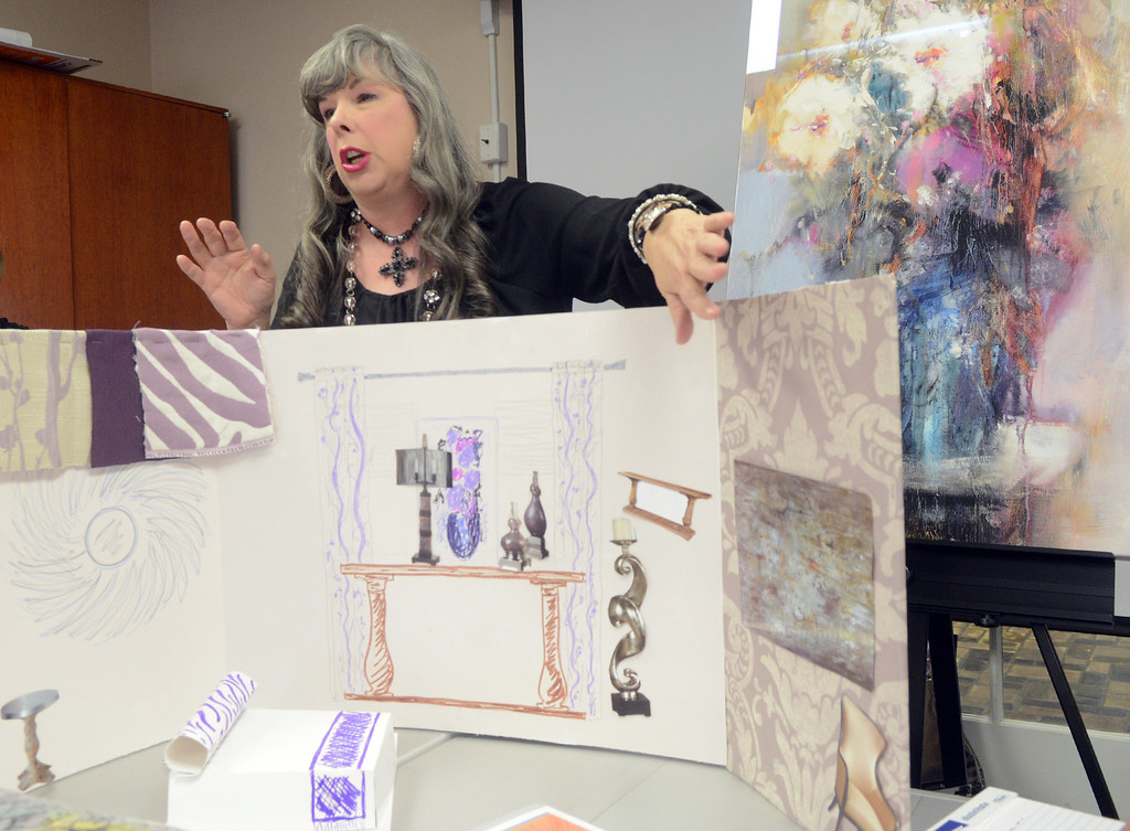Description of . Duncan Scott/DScott@News-Herald.com Betty Klammer presents her design ideas for a bedroom in the 2014 Lake County YMCA Dream House on April 7. This year's dream house is a brownstone located at The Residences at Willoughby Pointe in downtown Willoughby.