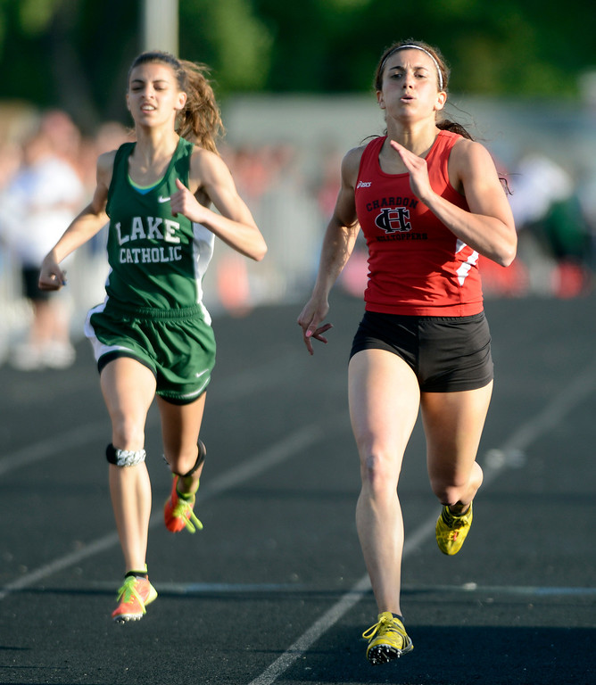 Description of . Maribeth Joeright/MJoeright@News-Herald.com<p> Chardon's Stephanie Ferrante finishes first and Lake Catholic's Frances Bull takes third in the girls 400 meter dash during the Divison I regional final meet.