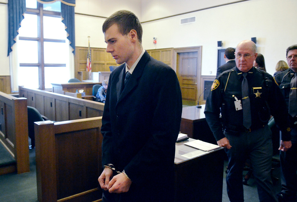 Description of . Jeff Forman/JForman@News-Herald.com Nathaniel Brown leaves Lake County Common Pleas Court Feb. 21 after being convicted on two of 11 counts in the 2011 killing of William Andrew Fayne Putzbach.