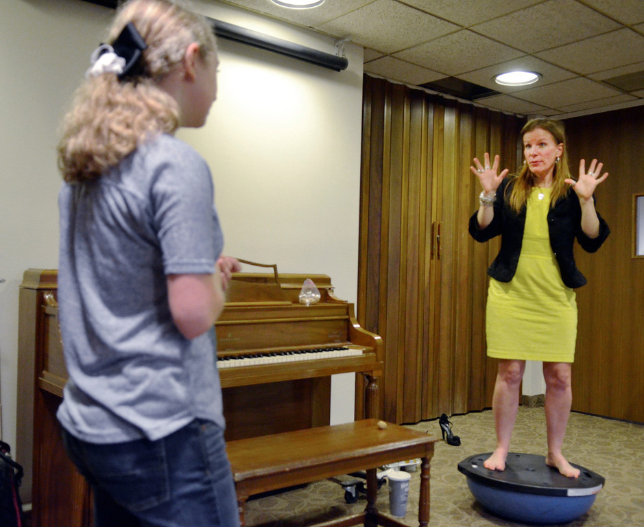 Description of . Jeff Forman/JForman@News-Herald.com Heidi Skok stands on a Bosu ball to demonstrate breathing technique as she gives a voice lesson April 14 to Michaela Quick, 15, at the Willoughby Fine Arts Association.