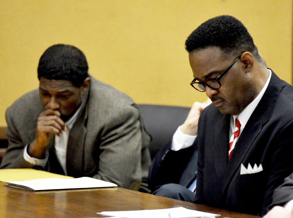 Description of . Jeff Forman/JForman@News-Herald.com Richard Muse and Robert Moore listen to a recording of Muse's conversation with an informant during their sentencing in Cuyahoga Common Pleas Court May 22.