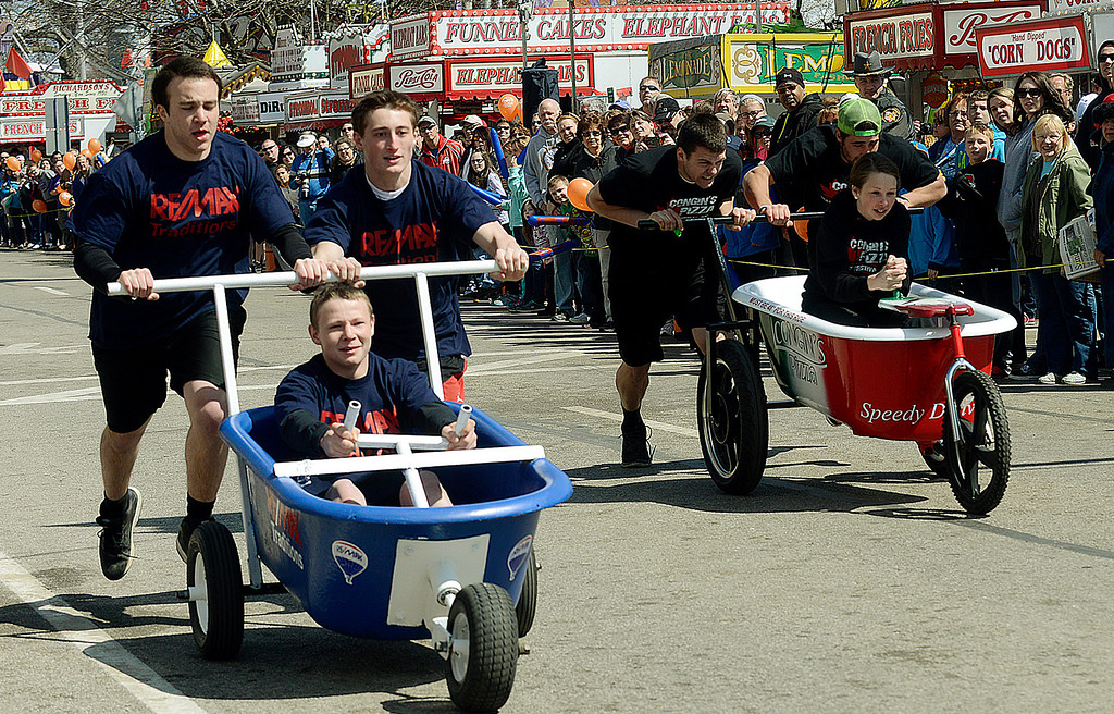 Description of . Maribeth Joeright/MJoeright@News-Herald.com Taking first place in the 30 and under division is the ReMax team of Evan Hornyak, driving, James Knopp, left, and Patrick Sullivan in the popular bathtub race event during the 85th annual Geauga County Maple Festival.
