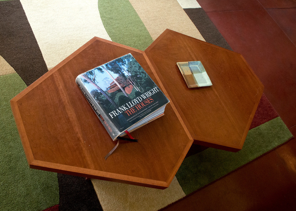 Description of . Duncan Scott/DScott@News-Herald.com A coffee table in the living room of the Frank Lloyd Wright designed Louis Penfield House in Willoughby Hills.