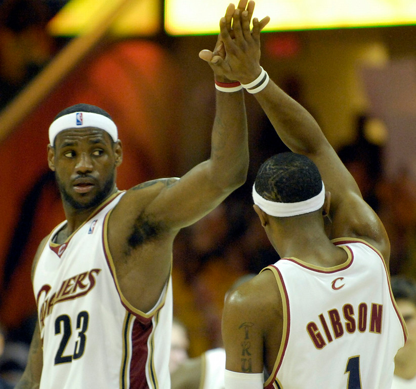 Description of . LeBron James congratulates teammate Daniel Gibson after Gibson's scoring drive in the second half of Monday's game against the Wizards.