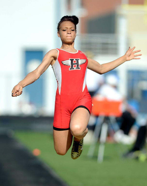Description of . Maribeth Joeright/MJoeright@News-Herald.com<p> Harvey's Alexis Daniels qualifies for the state meet with her long jump during the Division I regional finals, May 30, 2014.