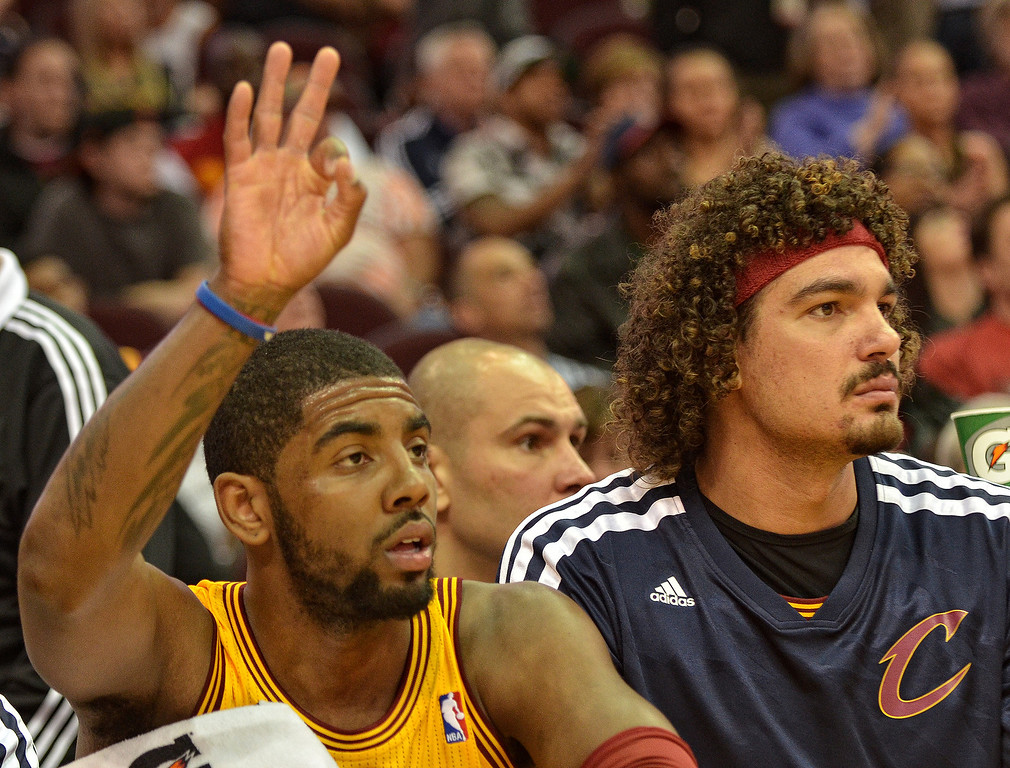 Description of . Michael Allen Blair/Digital First Media Cavs' guard Kyrie Irving signals a three point basket by teammate Jarret Jack while sitting on the bench with two fouls with center Anderson Varejao during the first quarter of Wednesday's game at Quicken Loans Arena. Big questions remain with Irving heading into the final year of his contract next season.