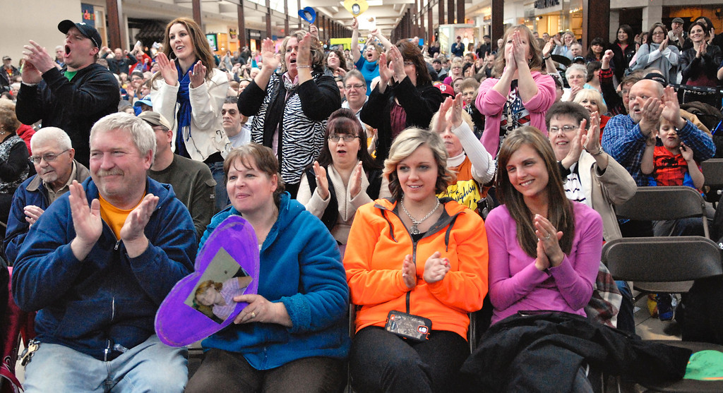 Description of . Jeff Forman/JForman@News-Herald.com Audience members cheer for their favorites at the Deepwood Idol Show March 29 at the Great Lakes Mall. The show was presented by the Lake County Board of Developmental Disabilities/Deepwood.