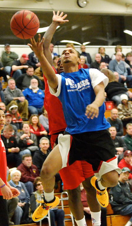 Description of . Jeff Forman/JForman@News-Herald.com Julio Stevens, Blue Team, goes up for a shot during the 36th News-Herald Classic March 29 at Lakeland Community College.