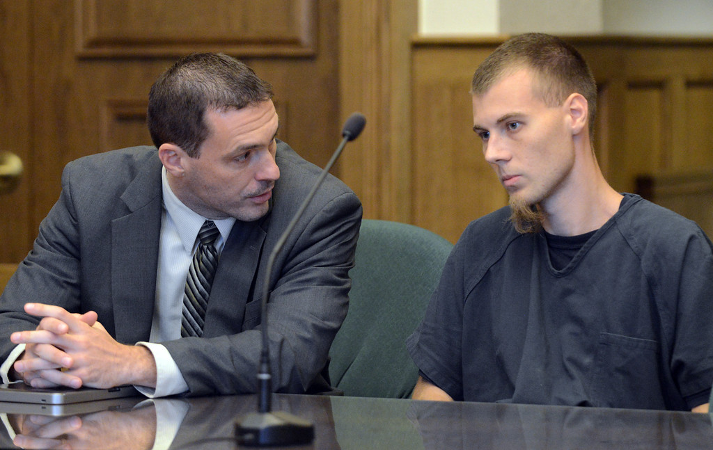 Description of . Duncan Scott/DScott@News-Herald.com Matthew Bangerter meets with Nathaniel Brown before a scheduled pretrial hearing on September 30, 2013, in Lake County Common Pleas Court. Brown's murder conviction in November, 2011 was overturned by the 11th District Court of Appeals. His pretrial hearing was delayed.