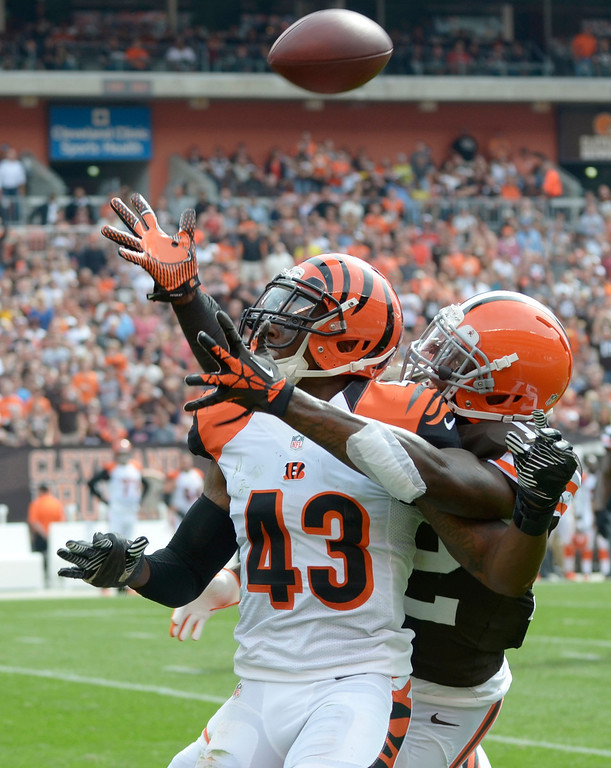 Description of . Jeff Forman/JForman@News-Herald.com Bengal's defender George Iloka tries to break up a pass to Browns wide receiver Josh Gordon in the second quarter. Pass interference was not called on the play.