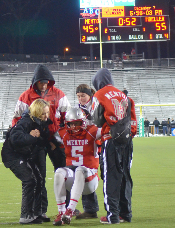 Description of . Michael Allen Blair/ MBlair@News-Herald.com Mentor quarterback Conner Krizancic is helped off the field after getting hit hard inside the redzone during the final Mentor drive of Saturday's 55-52 Div. I state championship game loss to Cincinnati Moeller at Fawcett Stadium in Canton.
