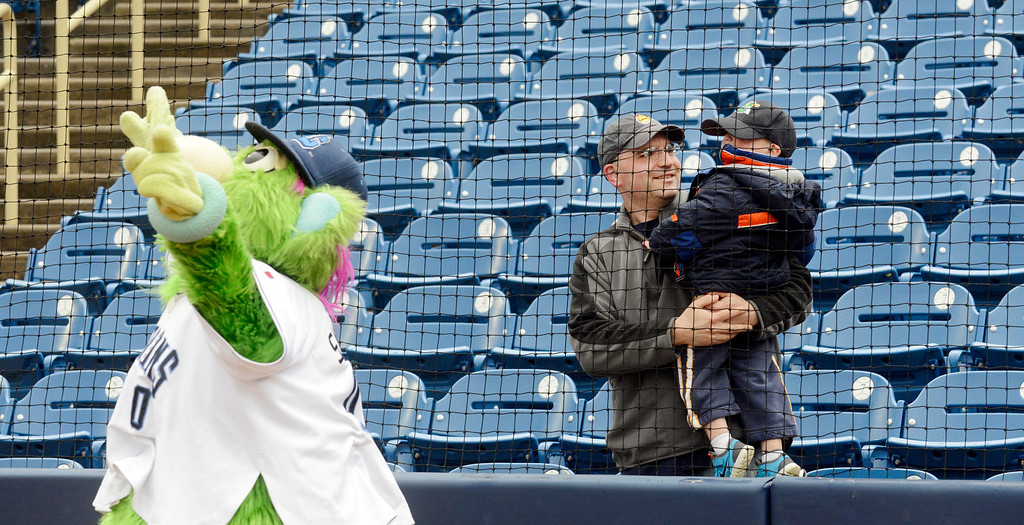 Description of . Maribeth Joeright/MJoeright@News-Herald.com<p> Robert Guttu of Mentor and his son Brody, 2, enjoy watching the antics of Captains mascot Skipper before the start of the home opener against Lansing, April 4, 2014.