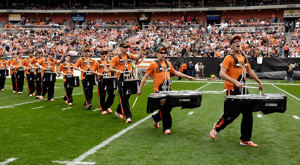 Description of . Jeff Forman/JForman@News-Herald.com The Cleveland Browns Drum Line takes the field Sunday before the  Browns' game against the Cincinnati Bengals Sunday at FirstEnergy Stadium.