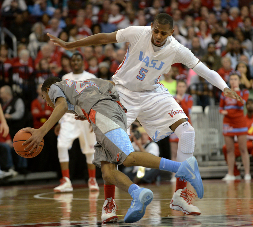 Description of . Duncan Scott/DScott@News-Herald.com VASJ's Dererk Pardon blocks the path of Lima Central Catholic's Martyce Kimbrough in the second quarter. VASJ' lost 64-62 in the Division III state championship game on March 22 in the Value City Arena in the  Schottenstein Center in Columbus.