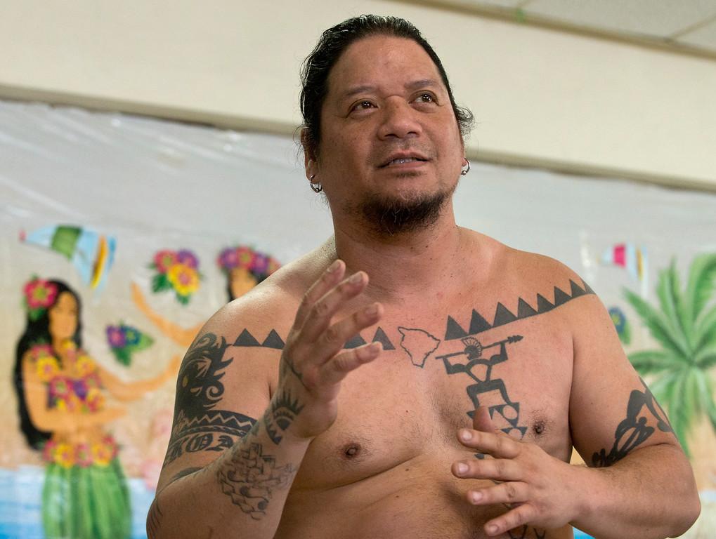Description of . Duncan Scott/DScott@News-Herald.com Ku'u Awai explains the meaning of the Hawaiian greeting Aloha during a luau on June 18 at the Lake County Board of Developmental Disabilities/Deepwood Vocational Guidance Center.