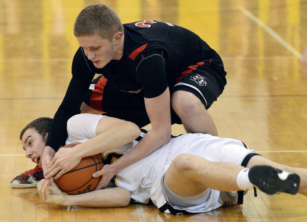 Description of . Duncan Scott/DScott@News-Herald.com Riverside's Ronnie Krsolovic and Chardon's Jason Janda wrestle for a loose ball in the fourth quarter. Riverside won Friday's PAC matchup 49-43 at the Riverside Community Field House.