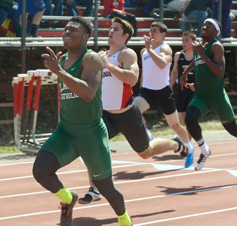 Description of . Maribeth Joeright/MJoeright@News-Herald.com Lake Catholic's Masai McDaniel pushes through the final yards and wins the boys 100 meter dash during the Hilltopper Invitational track meet, April 12, 2014.