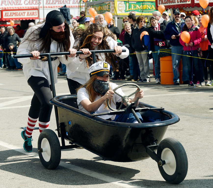 Description of . Maribeth Joeright/MJoeright@News-Herald.com<p> Members of the Chardon fast-pitch team, Cassidy King, driving, Nicole Kreuz, left, and Rachel Tusick give it all they have during the popular bathrub races at the 85th annual Geauga County Maple Festival, April 27, 2014. The girls dressed as pirates for the occasion.