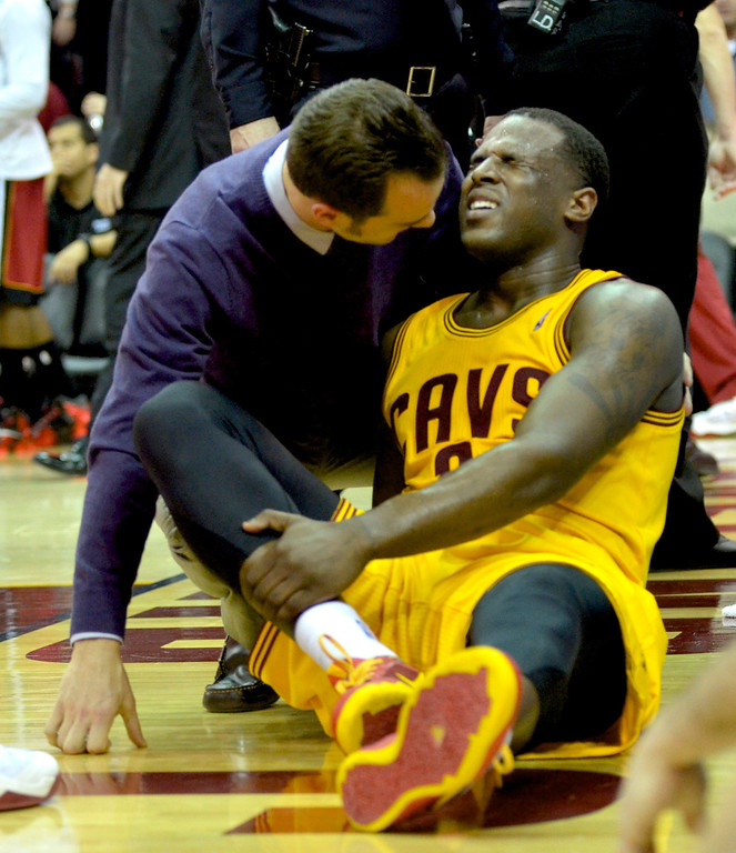 Description of . Jeff Forman/JForman@News-Herald.com Dion Waiters grimaces in pain after taking a hard fall in the fourth quarter of the Cavaliers' 100-96 loss to the Heat March 18 at Quicken Loans Arena.