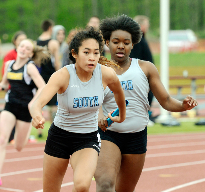 Description of . Maribeth Joeright/MJoeright@News-Herald.com<p> South's Amira Churn hands the baton to teammate and anchor Mischa Sellers in the girls 4X100 meter relay during the PAC meet.