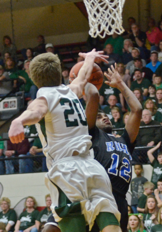 Description of . Jeff Forman/JForman@News-Herald.com Sean Walker's shot is blocked by Mitch Maasz in the first half of the Spartans' 59-45 Division IV regional semifinal win over Malvern March 11 at the Canton Field House.