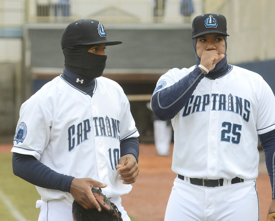 Description of . Maribeth Joeright/MJoeright@News-Herald.com<p> Captains second baseman Claudio Bautista, left, and first baseman Nellie Rodriguez do what they can to stay warm as they loosen up before the start of their opening game against the Lansing Lugnuts.