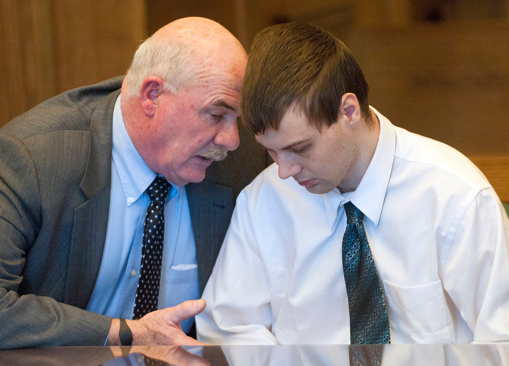 Description of . Duncan Scott/DScott@News-Herald.com Defense attorney John Luskin talks to Nathaniel Brown November 21, 2011 in Lake County Common Pleas Court before a jury convicted Brown of murdering William Andrew Fayne Putzbach.