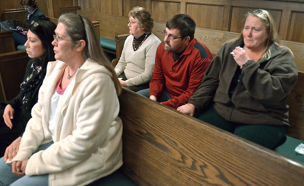 Description of . Jeff Forman/JForman@News-Herald.com William Andrew Fayne Putzbach's mother, Cathy Fayne, second from right, and uncle and aunt, Alvin and Lori Bunch, right, listen Feb. 21 in Lake County Common Pleas Court as Nathaniel Brown is convicted on two counts and found innocent on 11 counts in Putzbach's killing in 2011. Sitting with them are victim's advocates Michelle Corello, first row left, and Peggy Grant, second row left.