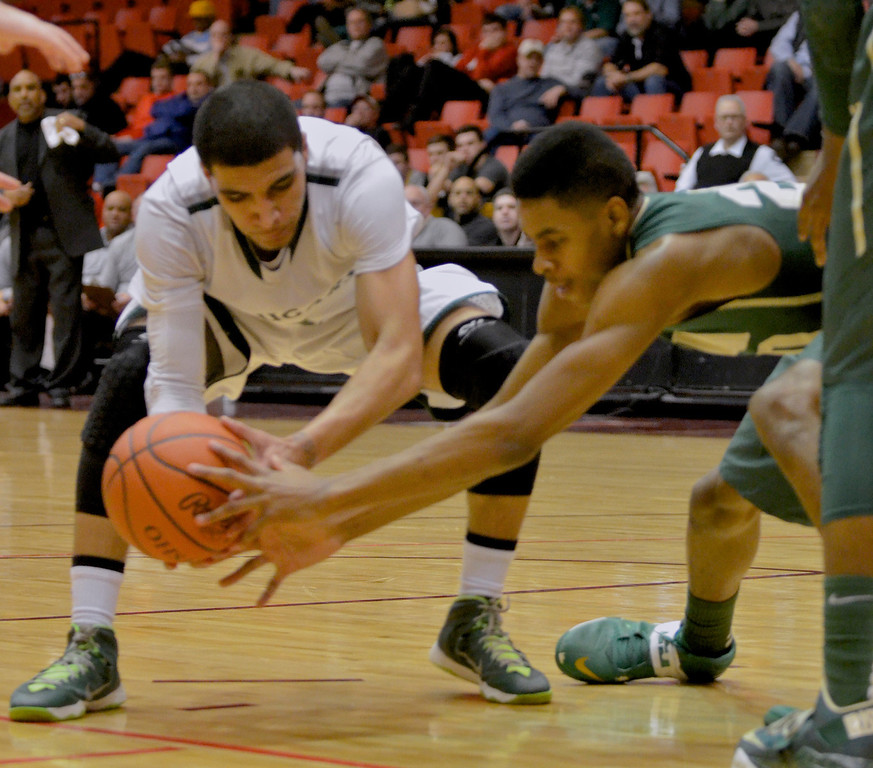 Description of . Jeff Forman/JForman@News-Herald.com Zavier Powers reaches for a lose ball in the fourth quarter of Lake Catholic's 68-52 Division II regional semifinal loss March 13 to St. Vincent St. Mary at the Canton Civic Center.
