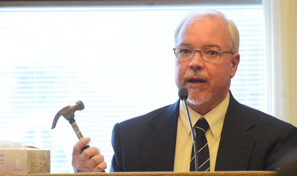 Description of . Maribeth Joeright/MJoeright@News-Herald.com Dr. Stephen LaBonne of the Lake County Crime Lab displays a hammer that was used to murder William Andrew Fayne Putzbach in 2011. LaBonne was on the stand, Wednesday, before Lake County Common Pleas Judge Richard L. Collins for the retrial of Nathaniel Brown.