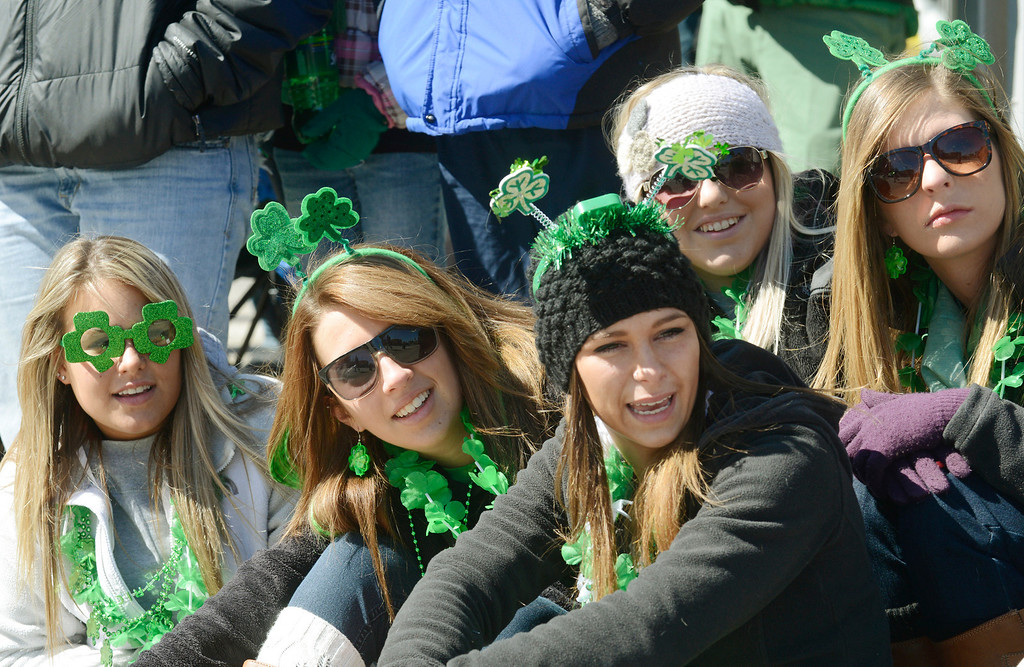 Description of . Maribeth Joeright/MJoeright@News-Herald.com<p> Eastlake North seniors, from left, Iva Bradvica, Kourtney Kline, Sam Hoefle, Courtney Jeschelnig and Shannon Kokish take in the sights and sounds of the 147th annual St. Patrick's Day parade in Cleveland, March 17, 2014.