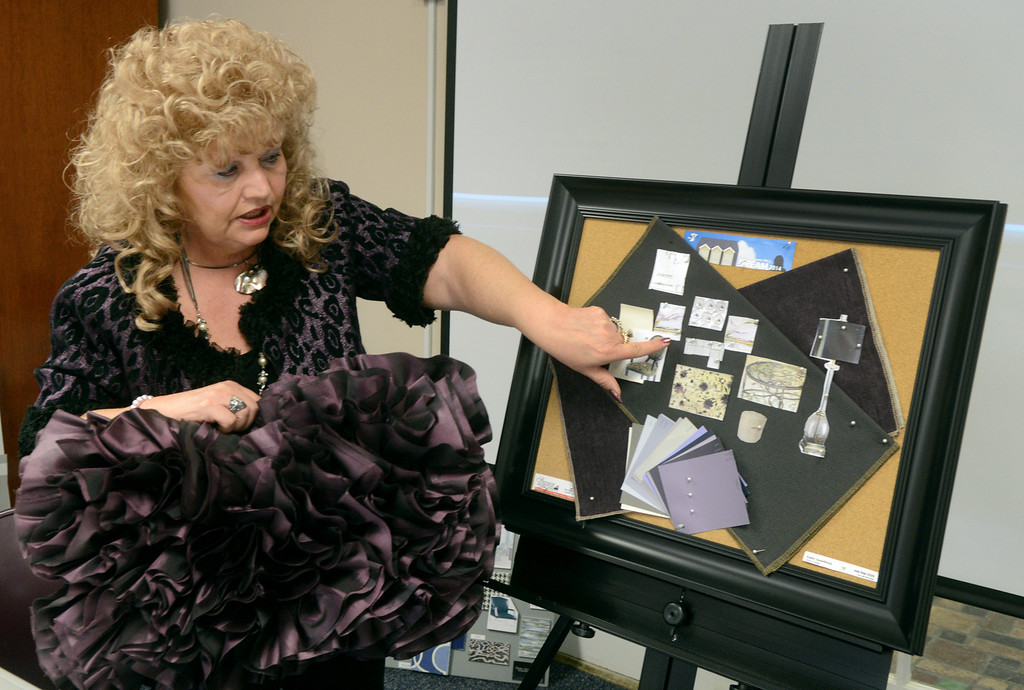 Description of . Duncan Scott/DScott@News-Herald.com Kathy Snowbrick of Sheraton Furniture presents her design for the living room of the 2014 Lake County YMCA Dream House.