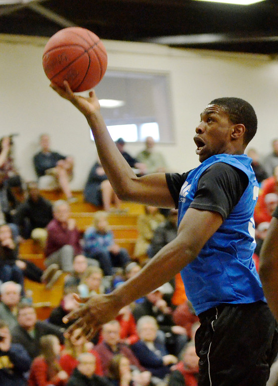 Description of . Jeff Forman/JForman@News-Herald.com Dontez Lockett shoots during the 36th News-Herald Classic March 29 at Lakeland Community College.