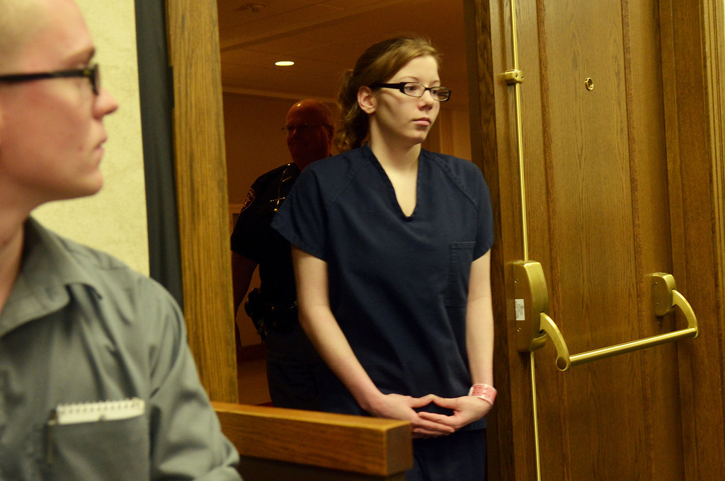 Description of . Michael Allen Blair/MBlair@News-Herald.com Foster daughter Sabrina Zunich enters Judge Joe Gibson's courtroom for the first time to provide testimony in Kevin Knoefel's murder conspiracy trial in Lake County Common Pleas Court on  June 5, 2014.