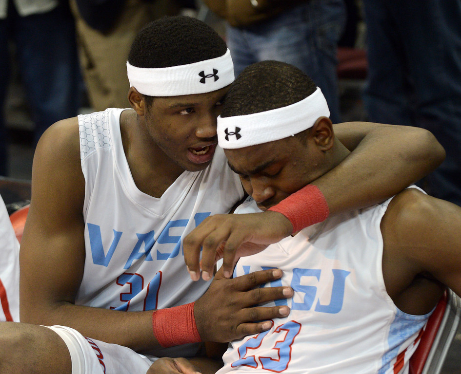 Description of . Duncan Scott/DScott@News-Herald.com VASJ's Carlton Bragg consoles Deandre Forte after VASJ lost to Lima Central Catholic 64-62 in the Division III state championship game on March 22 in the Value City Arena in the  Schottenstein Center in Columbus.