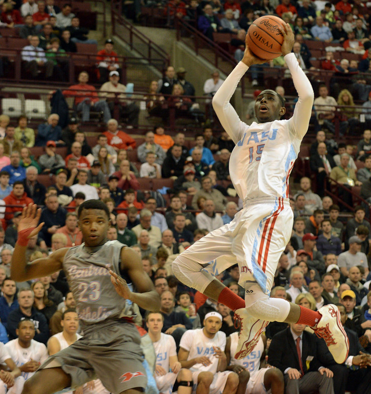Description of . Duncan Scott/DScott@News-Herald.com VASJ's Simon Texidor IV scores in the third quarter of VASJ's 64-62 loss to Lima Central Catholic in the Division III state championship game on March 22 in the Value City Arena in the  Schottenstein Center in Columbus.