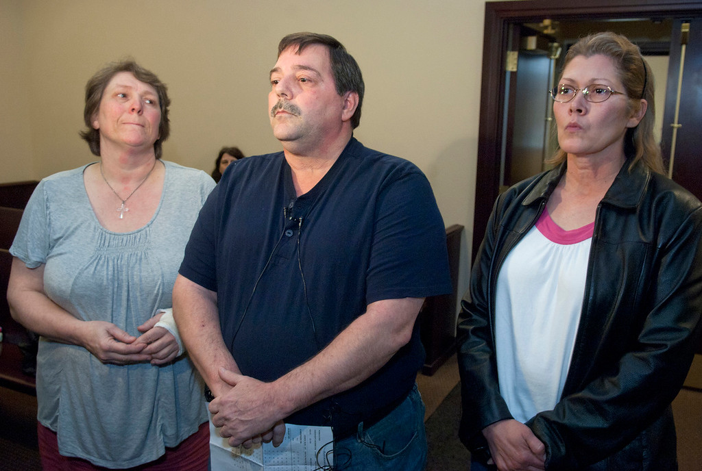 Description of . Duncan Scott/DScott@News-Herald.com From left, Kimberly and Frederick J. Putzbach, and Cathy Fayne, murder victim William Andrew Fayne Putzbach's stepmother, father and mother, make a statement April 20, 2011 in Willoughby Municipal Court following the arraignments of suspects Kyle Basinger, Ronald Shirer and Nathaniel Brown on murder charges.