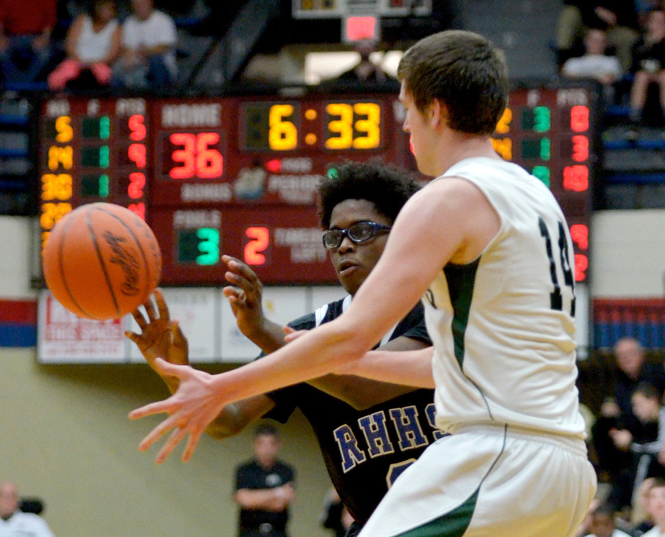 Description of . Jeff Forman/JForman@News-Herald.com Mory Bamba passes to a teammate in the fourth quarter of the Spartans' 59-45 Division IV regional semifinal win over Malvern March 11 at the Canton Field House.