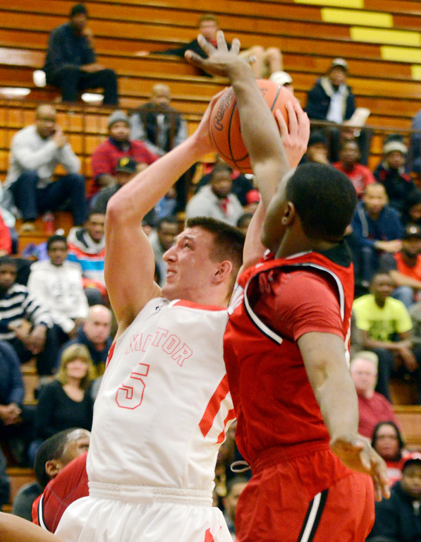 Description of . Maribeth Joeright/MJoeright@News-Herald.com Glenville's Terrell Goss blocks a shot by Mentor's Conner Krizancic in the fourth quarter of the Division I district semifinal game, March 6, 2014.