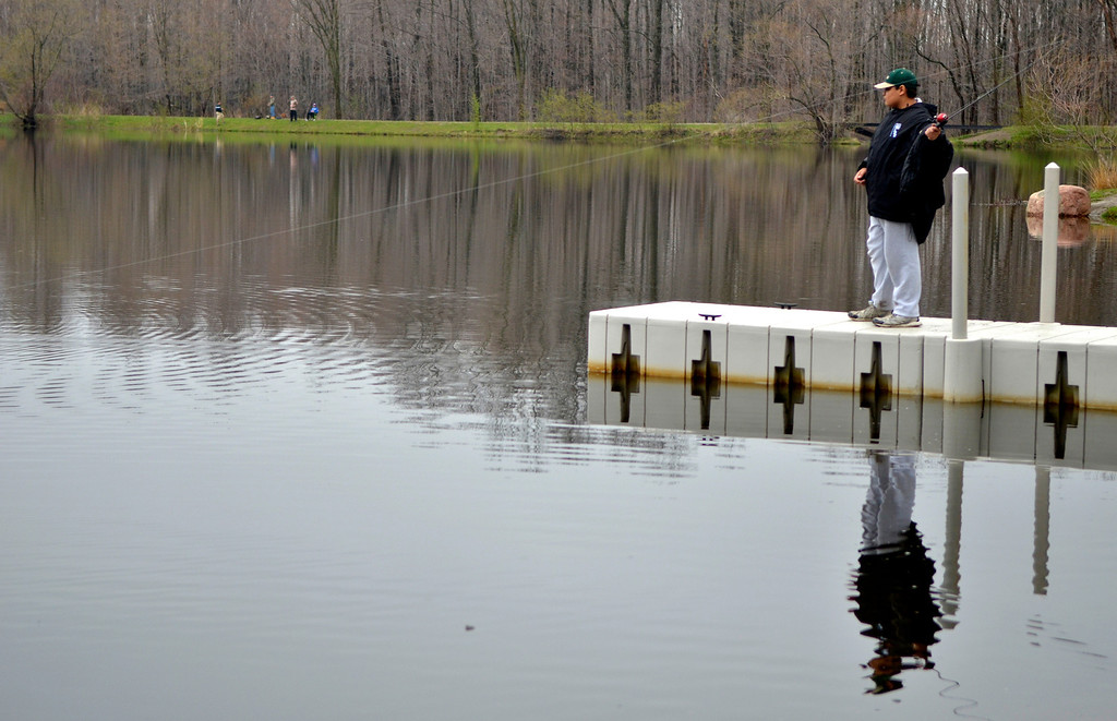 Description of . Jeff Forman/JForman@News-Herald.com Marcus Manzi, of Willoughby, casts his line during the Lake Metroparks Fantastic Fishing program for people with disabilities April 30 at Hidden Lake in Leroy Township.