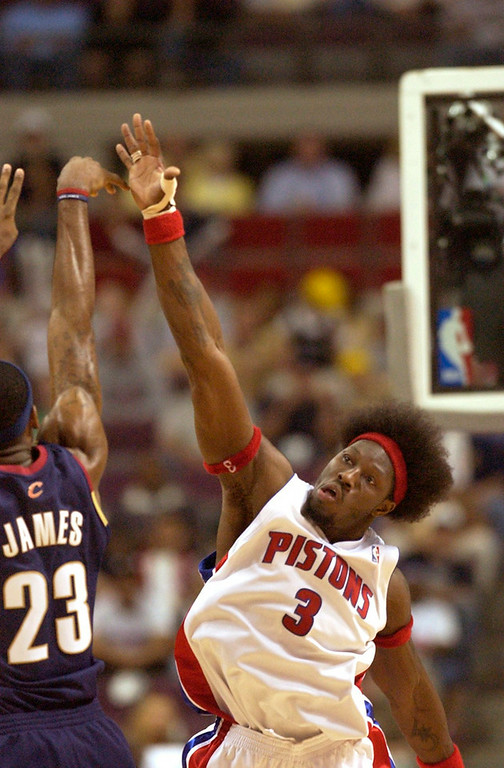 Description of . Cleveland Cavaliers at Detroit Pistons. NBA playoffs Round 2, Game 2. Pistons Ben Wallace tries to block the shot of Cavs LeBron James late in the 4th quarter.  The Oakland Press/DOUG BAUMAN