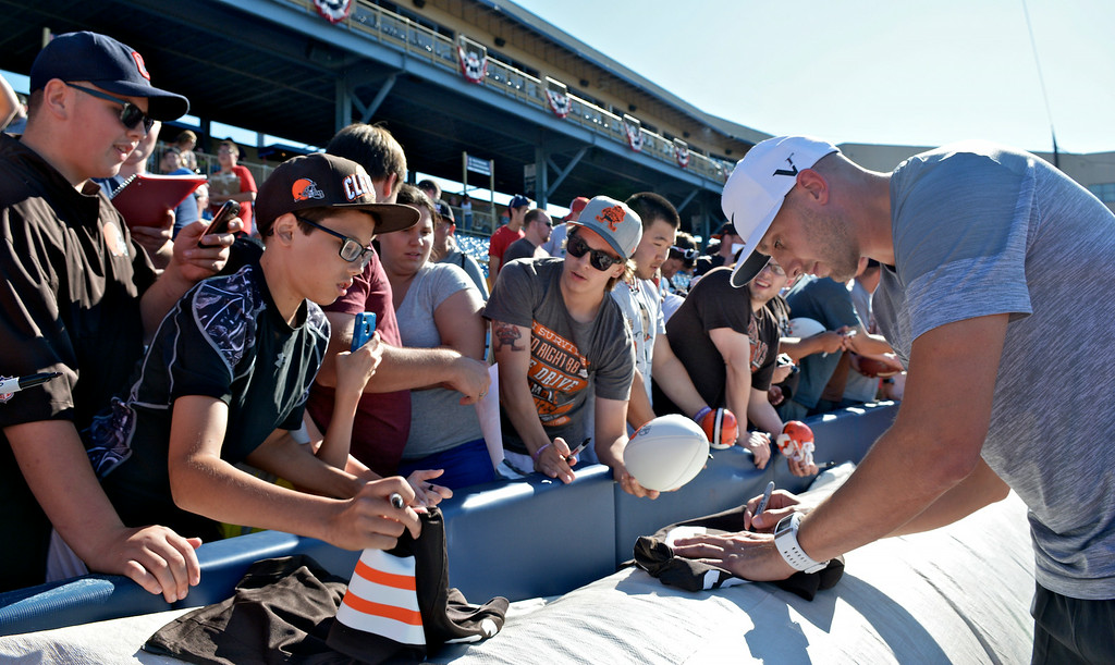 Description of . Jeff Forman/JForman@News-Herald.com Brian Hoyer signs autographs before  the Joe Haden and Friends Softball Game July 17 at Classic Park.