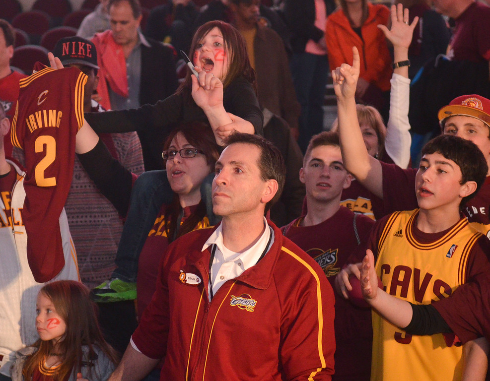 Description of . Michael Allen Blair/Digital First Media Cavs' fans yell for autographs after a game April 16 versus the Nets at Quicken Loans Arena.