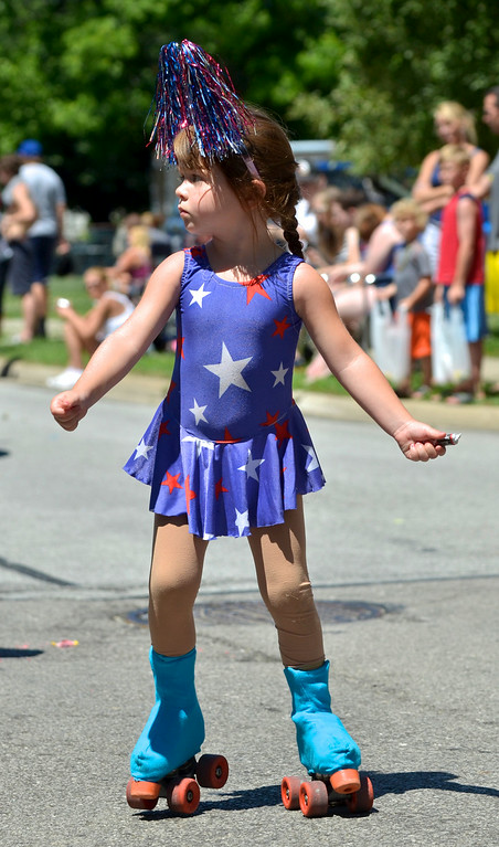 Description of . Jeff Forman/JForman@News-Herald.com Reese Layto skates with the Mentor Artistic Skate Club in the Mentor Headlands July 4th Parade.