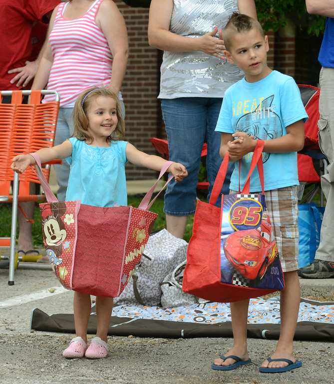Description of . Maribeth Joeright/MJoeright@News-Herald.com<p> Abigail Sturgill, 4, and Ricky Wolanin, 7, of Perry Township hold their bags and eagerly wait for candy to be thrown during the Fairport Harbor Mardi Gras parade to kick off the July 4th holiday festivities.