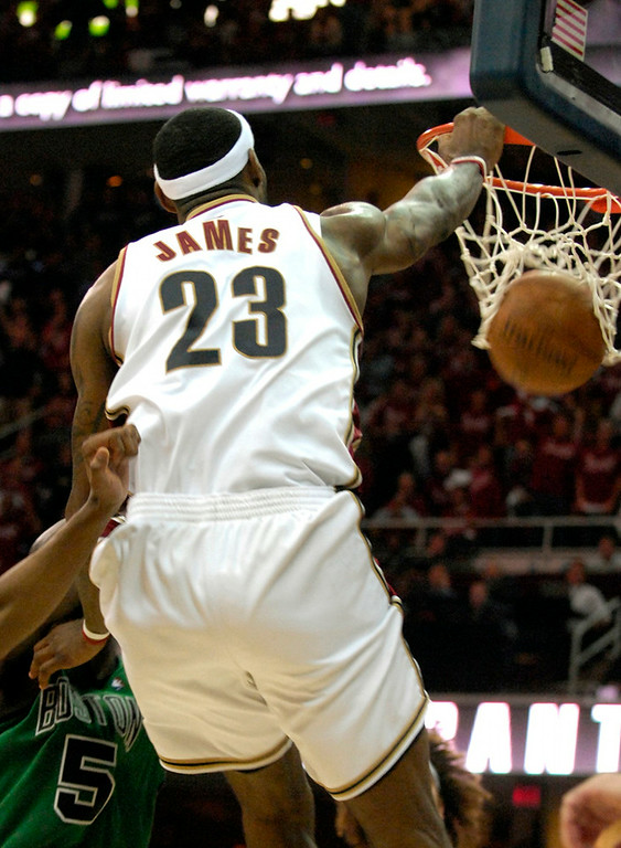 Description of . LeBron James dunks with 1:45 minutes to go in the fourth quarter against Boston.