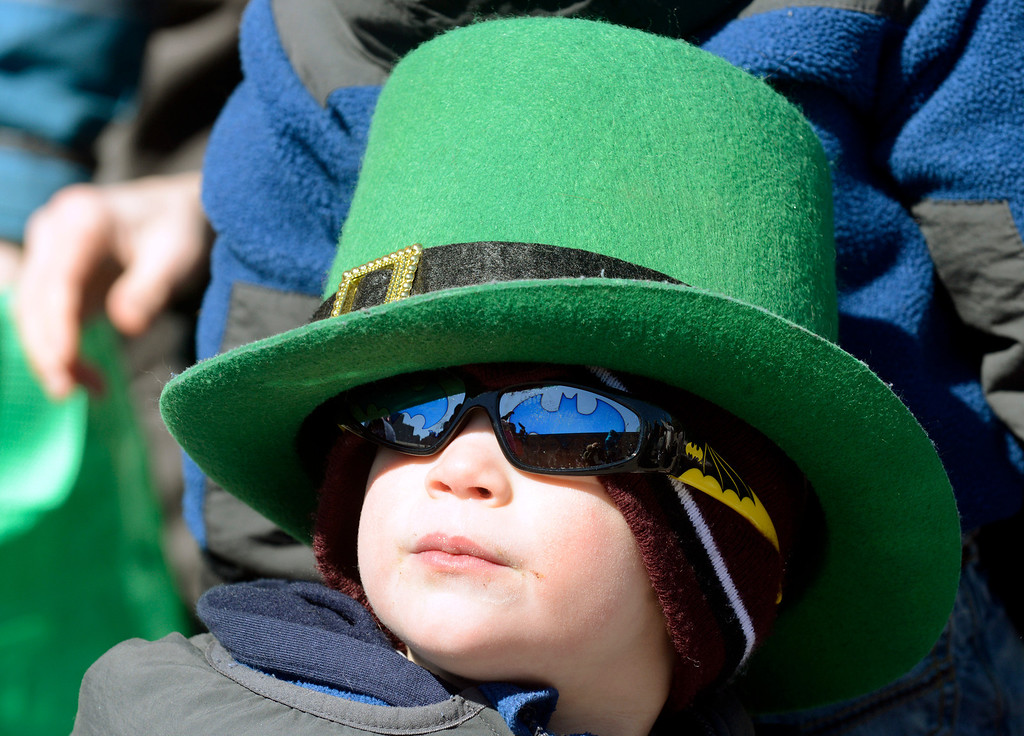 Description of . Maribeth Joeright/MJoeright@News-Herald.com<p> Rocco Coale, 3, of Rocky River, clad in his St. Patrick's themed hat and Batman sunglasses watches the 147th annual parade with his family, March 17, 2014.