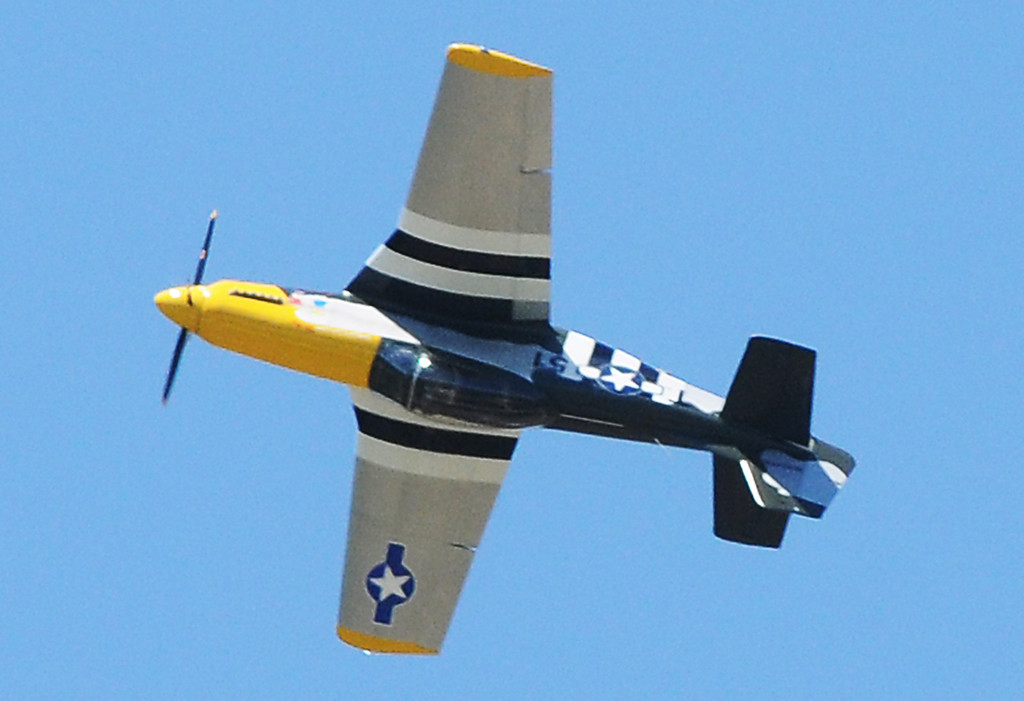 Description of . Jim Bobel/JBobel@MorningJournal.com A Titan T-51 flys upside down over the crowd at the Discover Aviation Air Show at the Lorain County Regional Airport. The plane is a three quater scale version of the World War II P-51 Mustang fighter plane. The plane is made in northeast Ohio.