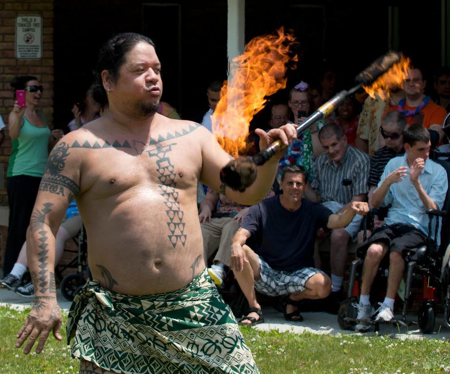 Description of . Duncan Scott/DScott@News-Herald.com Fire dancer Ku'u Awai performs during a luau on June 18 at the Lake County Board of Developmental Disabilities/Deepwood Vocational Guidance Center.