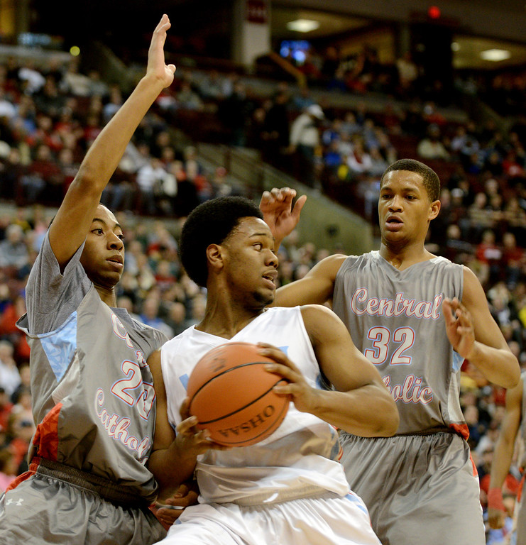 Description of . Duncan Scott/DScott@News-Herald.com VASJ's Brian Parker is defended by Martyce Kimbrough, left, and Dantez Walton during VASJ's 64-62 loss to Lima Central Catholic in the Division III state championship game on March 22 in the Value City Arena in the  Schottenstein Center in Columbus.